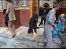 Cleaning the shrine of the commander of the faithful, Imam Ali (A.S)