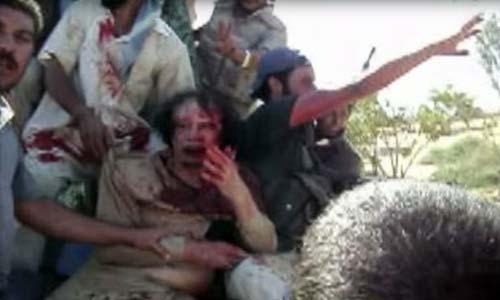 فيديو جديد وصور لم ينشروا من قبل لمعمر القذافي قبل اعدامه!